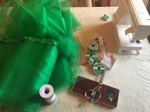 12 yards of green tulle and lots of ribbon